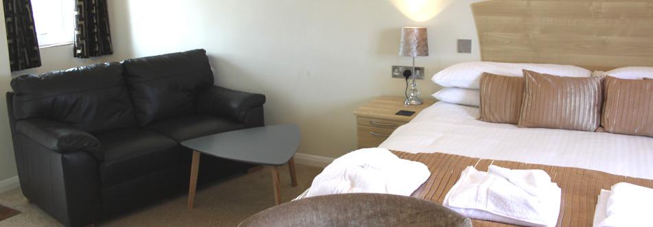 Sandpiper Lodge Bed and Sofa Area